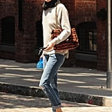 Olivia cozied up to a gray sweater, an adorable dotted scarf, and a luxurious tweed bag in NYC.