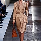 Perhaps Kate would be interested in Riccardo Tisci's new vision for the Burberry brand and invest in a champagne silk trench? We think this piece would look quite lovely layered over one of Kate's famous printed day dresses.