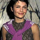 Helena Christensen wore a lace top and a pixie cut backstage in 1997.