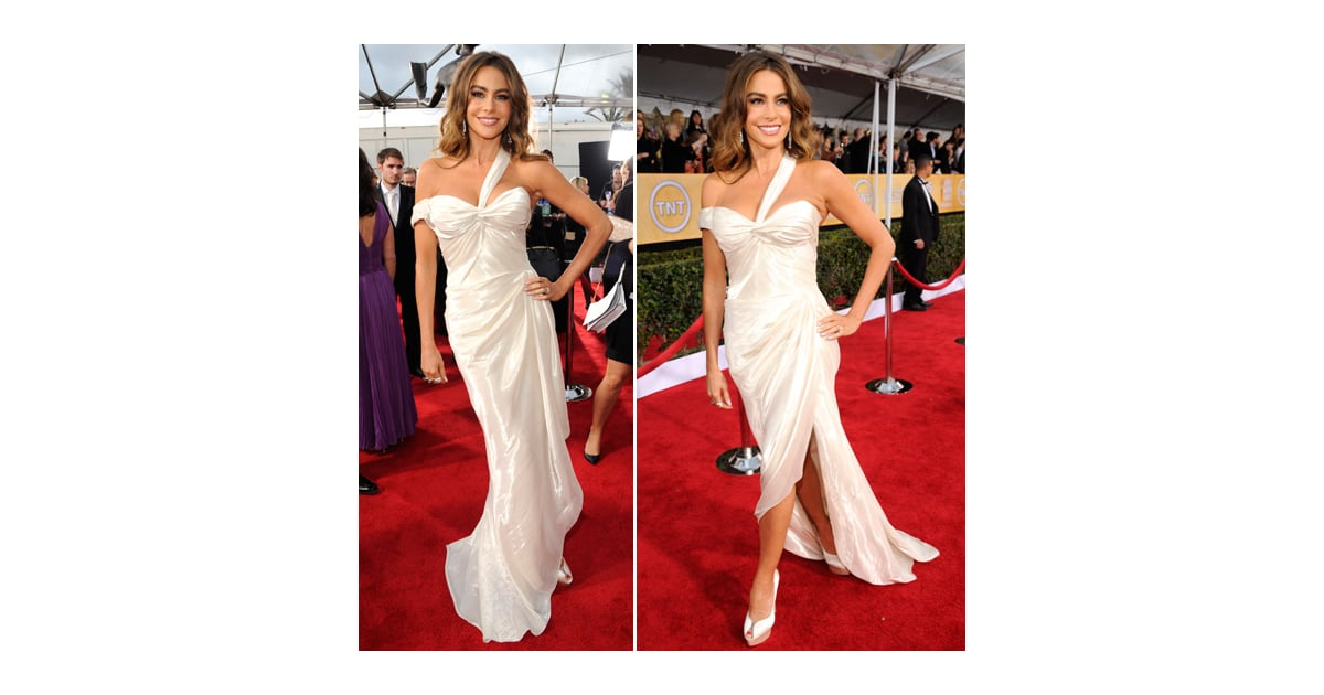 PopsugarFashionSofía VergaraSofia Vergara: SAG Awards Red Carpet Dresses 2013SAG Awards: Sofia VergaraJanuary 27, 2013 by Robert Khederian8 SharesChat with us on Facebook Messenger. Learn what's trending across POPSUGAR.Sofia Vergara stepped onto the red carpet tonight in a Donna Karan Atelier gown whose pearly-white drapery did nothing but accent her bombshell curves. Sofia kept the sex appeal on high alert with her dress's thigh-high slit, which parted to showcase her covetable shoes: peep-toe Charlotte Olympia pumps in a matching shade of white. Diamond drop earrings — which peeked out from behind her wavy hair — and equally sparkling rings, both from Neil Lane, finished her outfit off with additional shine. Are you on board with Sofia Vergara's look?Vote on all of our SAG Awards polls here!Image Source: Getty Join the conversationChat with us on Facebook Messenger. Learn what's trending across POPSUGAR.Donna Karan AtelierAward SeasonCharlotte OlympiaNeil LaneRed CarpetSofía VergaraSAG AwardsCelebrit - 웹