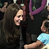Kate couldn't help but beam while talking to a baby girl at London's Fostering Network event in January 2015.