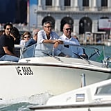 George Clooney arrives at the Venice Film Festival on a boat.