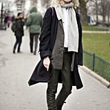 Laid-back in leather pants, biker boots, and tomboy layers.