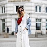A White Button-Down Dress With a Denim Jacket and Red Fanny Pack