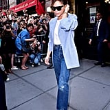 The previous day, Victoria had worn the same heels with a white t-shirt, blazer, and jeans.