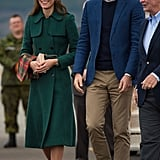 Kate covered up her Dolce & Gabbana dress with a green coat by Hobbs, one of her favorite brands, during her and Prince William's arrival in Whitehorse, Canada.
