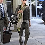 Heidi Klum mixed and matched relaxed prints, then added laid-back slip-ons, to achieve this vacation-ready look.