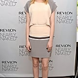 Emma sported this polished nude-and-gray Daniel Vosovic raglan-sleeved dress with peachy Rupert Sanderson pointy-toe pumps for a Revlon event in December 2012.