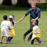 Prince Harry adorably played ball with children.