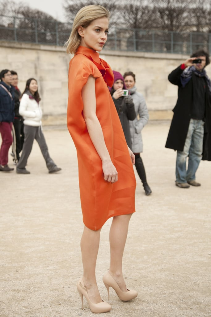 Leigh Lezark turned heads in a tangerine-hued sheath.