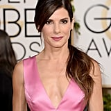 Sandra Bullock has been turning it out this year, and tonight's elegance was no exception. A side-parted low ponytail and mauve pout exuded a carefree adolescence.