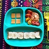 """""""Lunch: cheddar cheese, roasted red bell pepper hummus with heirloom cherry tomatoes, and sprouted bread with banana and peanut butter."""""""