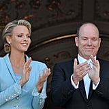 Princess Charlene of Monaco and Prince Albert II of Monaco clap from the balcony.