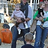 Rebecca Gayheart had a smile on her face as she carried her daughter Georgia through Mr. Bones Pumpkin Patch in LA.