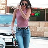 Kendall held onto her red Louis Vuitton pouch, which she finished with a furry Fendi key chain.