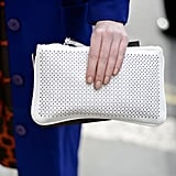A perforated white clutch added a refreshing Spring touch against a cobalt blue coat.