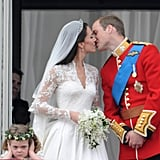 . . . but the 3-year-old was in a grumpier mood as the newlyweds had their first kiss on the balcony at Buckingham Palace.