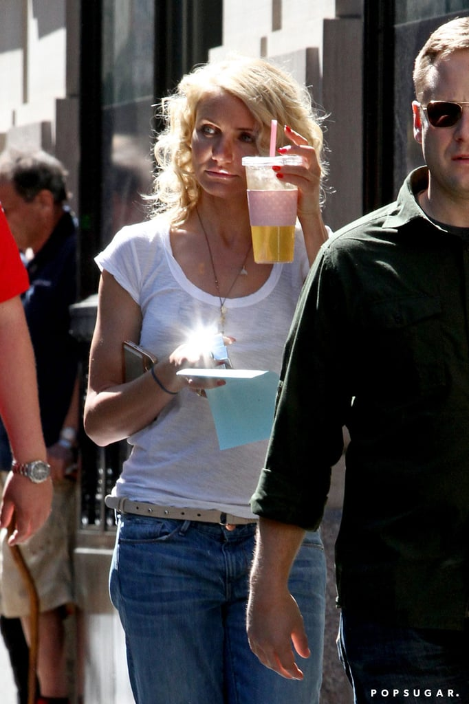 Cameron Diaz grabbed a beverage between takes.