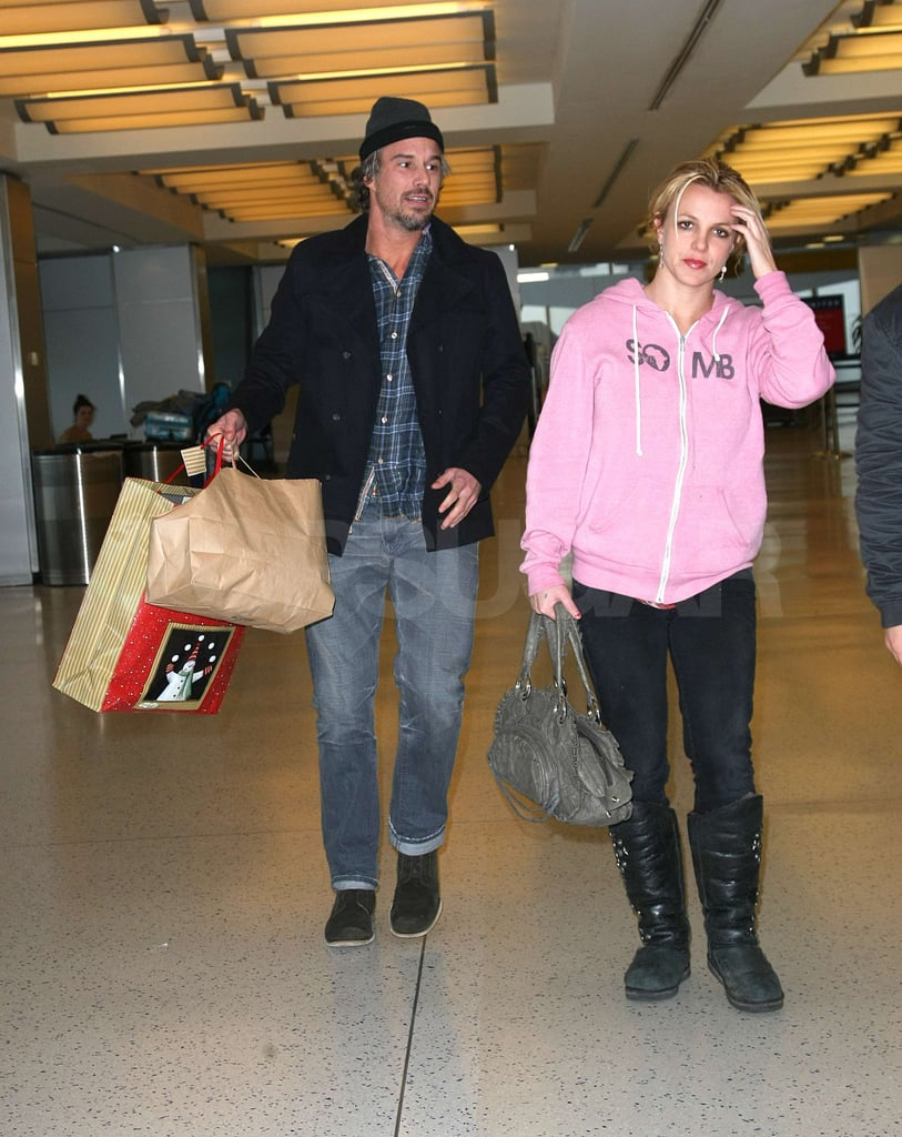 """Britney Spears and Jason Trawick were side by side going through security at JFK airport in NYC this afternoon. It's been a relatively quiet month for the pop star as she gears up to spend the holidays with her family. She twittered about watching Sean Preston and Jayden James's Christmas show last weekend, calling it the """"cutest thing ever!"""" Rumors have been swirling that there's a single from Britney coming soon ahead of her March album release, though the only thing she's confirmed is a photo shoot with Mario Testino earlier in December. Britney once again has one of our hottest bikini bodies of the year and we're looking forward to a huge 2011 with new music from Miss Spears!"""