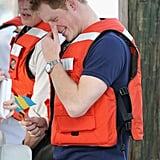 Harry smiled as he put on his life jacket as he left Harbour Island in the Bahamas.