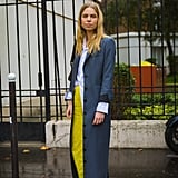 Wear a Long Coat With a Button-Down and a Colorful Skirt