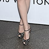 A zoom-in on Emma's shoes reveals fabulous embellishments that took her peep-toes to shiny heights.