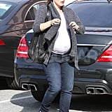 Pregnant Jennifer Garner wrapped up in a warm sweater.