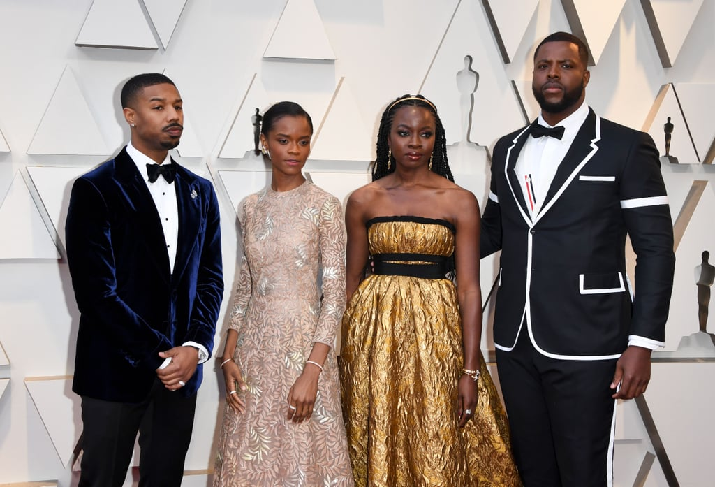 Never let it be said that the Black Panther crew doesn't know how to shut down a carpet, because it would be nothing other than pure blasphemy. The cast of the three-time Oscar-winning Marvel film graced the Academy Awards on Sunday night with their regal presence and — as usual — they came dressed to the nines.  Angela Bassett reminded us that the Queen Mother will always stun like no other in a custom pink Reem Acra gown, Danai Gurira shimmered like gold, and Letitia Wright looked like an actual fairy come to life. Though Lupita Nyong'o skipped the red carpet, the actress definitely didn't miss out on all the festivities, linking up with her costars later on in the night. Chadwick Boseman, Winston Duke, Michael B. Jordan (along with his mom!), and Ryan Coogler were not to be outdone, all proving that there's nothing boring about tuxes when they're done right. Black Panther's Ruth E. Carter and Hannah Beachler — winners of best costume design and production design, respectively — were also in the mix, showing that good taste runs throughout the entire team!  Honestly, it's kind of unfair for a cast to look that good and also be that talented. Check out the best photos of the Black Panther cast at the 2019 Academy Awards ahead!      Related:                                                                                                           Who's Nominated For an Oscar This Year? Brush Up on the Nominations