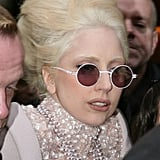 Gaga digs pink pearls and round shades.