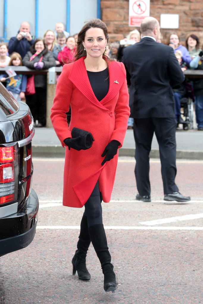 Kate Middleton wore a red Armani coat.