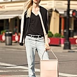 Upgrade your basics by pairing relaxed jeans and sneakers with a structured bag that's sure to catch everyone's eye.