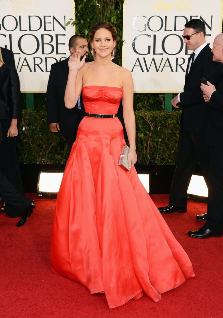 Jennifer Lawrence stunned the crowds when she hit the Golden Globes red carpet in this coral red gown by Dior Couture on January 13.
