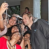 Alexander Skarsgard poses with fans at the Melancholia premiere.
