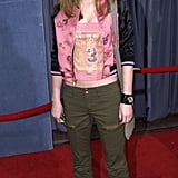 Leighton opted for a silky version to wear underneath her bomber.