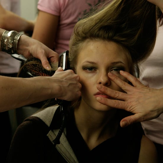 A model gets double the service backstage, sitting for hair and makeup simultaneously.  Photo: Megan Holmes