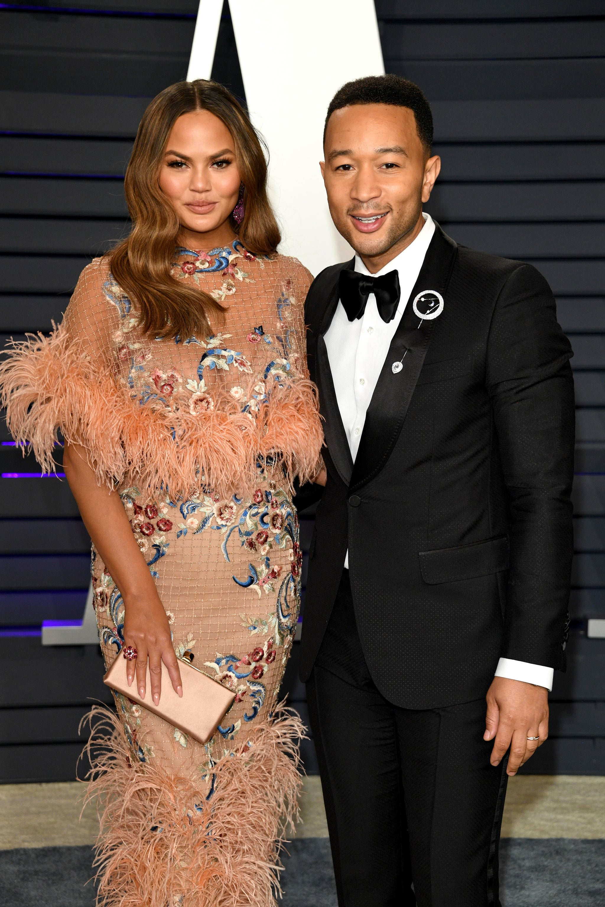 BEVERLY HILLS, CALIFORNIA - FEBRUARY 24: Christine Teigen  and John Legend attend 2019 Vanity Fair Oscar Party Hosted By Radhika Jones   at Wallis Annenberg Center for the Performing Arts on February 24, 2019 in Beverly Hills, California. (Photo by Daniele Venturelli/WireImage)