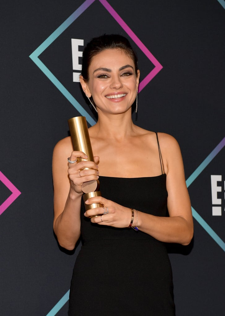 "Mila Kunis stepped out solo for a fun outing at the 2018 E! People's Choice Awards on Sunday. She accepted the award for favorite comedy movie for The Spy Who Dumped Me and was also nominated in the comedy movie star category for her role in the film. In her acceptance speech, Mila brought attention to the devastating wildfires in California, which she described as ""in a state of emergency."" She then urged viewers to donate to the Los Angeles Fire Department. See pictures from her night out ahead, and read the complete winners' list here.      Related:                                                                                                           Get Ready For the People's Choice Awards With a Look Back at Last Year's Best Dressed"