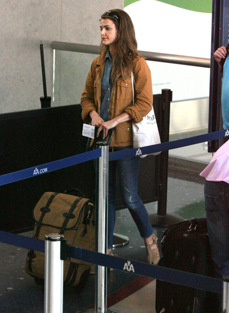 Keri Russell checked in for a fight out of LAX on Thursday with her Filson carry-on. The Big Apple-based star was off tending to business on the West Coast, hopefully working on new projects after her last series, Running Wilde, was cancelled last season. She has a big screen project hitting theaters in the coming months. She stars in Goats alongside David Duchovny, though no release date has been set just yet. Keri has lots to do back home with her boys Shane and River. Elle Decor gave a peek inside Keri Russell's Brooklyn home in their June issue, in which the actress credited her handy husband Shane for handling the bulk of their renovation.