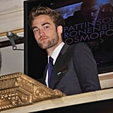Robert Pattinson wore a suit and a blue tie to open the New York Stock Exchange.