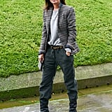 """Emmanuelle Alt reworked a variation on her """"uniform"""" in a pair of gray trousers and a printed blazer."""