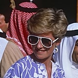 Wearing the white-framed aviators, Diana chose a Catherine Walker printed outfit along with a moon earring while in Riyadh, Saudi Arabia.