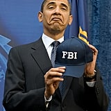 Showing off his FBI hat in 2009.