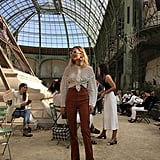 Style Your White Eyelet Top With Brown High-Waisted Pants