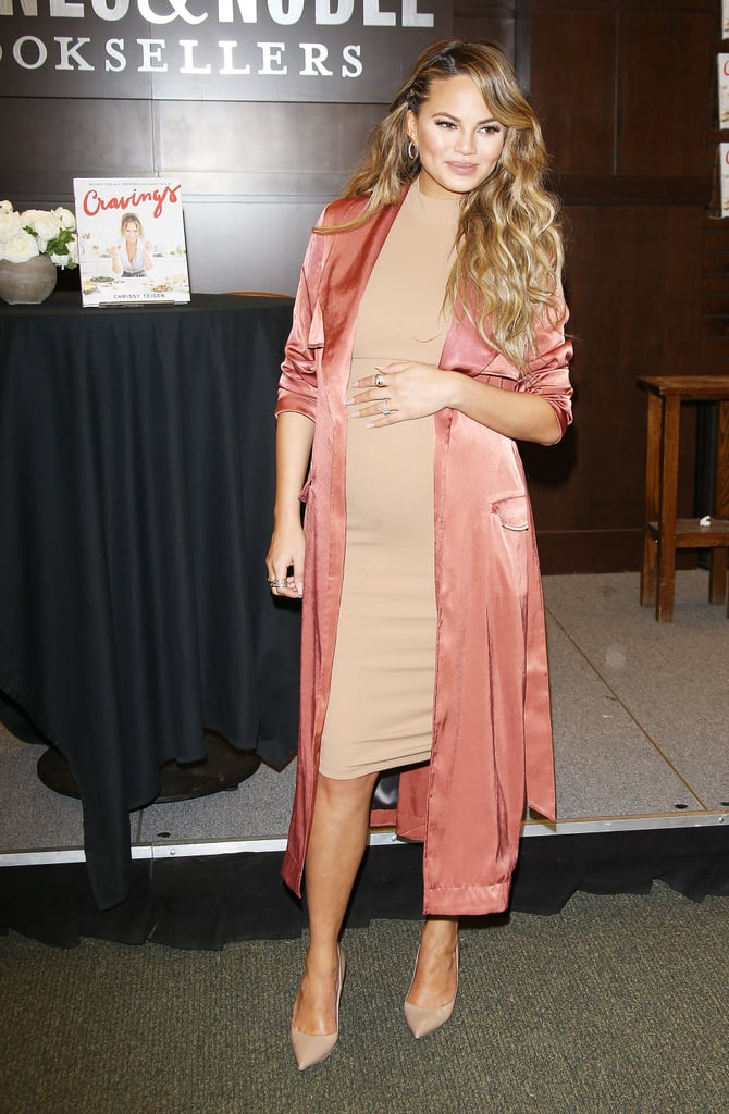 Chrissy worked a knee-length dress with a tangerine silk robe and pointed-toe pumps for a book signing at Barnes & Noble.