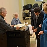 Side by side, the Romneys submitted their votes.