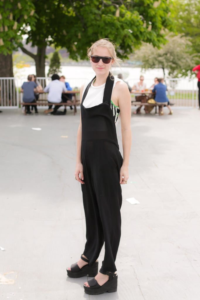 Overalls got a lift with black platforms and a geometric print tank peeking out from underneath. BFAnyc.com