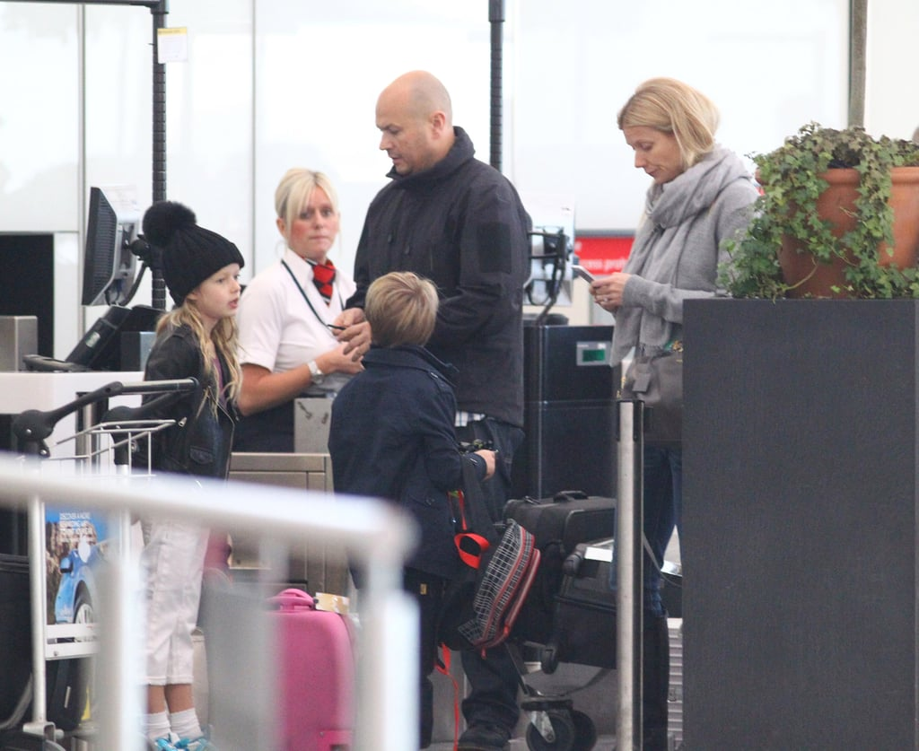 Gwyneth Paltrow made her way through London's Heathrow airport with Apple Martin and Moses Martin.