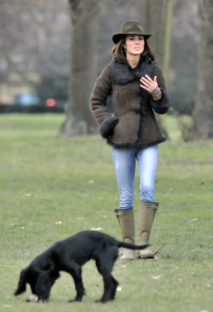 Kate Middleton and her dog Lupo went for a stroll in London's Kensington Gardens on Monday with her royal protection officer. She was decked out in a familiar ensemble, a LK Bennett shearling jacket and Le Chameau rain boots. Kate wore a similar get-up in December when she and Prince Harry ventured to the English countryside to watch Prince William play a Christmas Eve soccer game. On Tuesday, though, Kate wore Orla Kiely for her latest solo outing. Kate visited with primary school children at the Rose Hill School in Oxford, and watched them paint and recite poetry. She traveled there as a patron of the Art Room charity, which aims to help underprivileged youngsters through creative pursuits. It was there that Kate finally revealed the name of her and William's puppy. She told a youngster that they named him Lupo, after the Italian name for wolf.