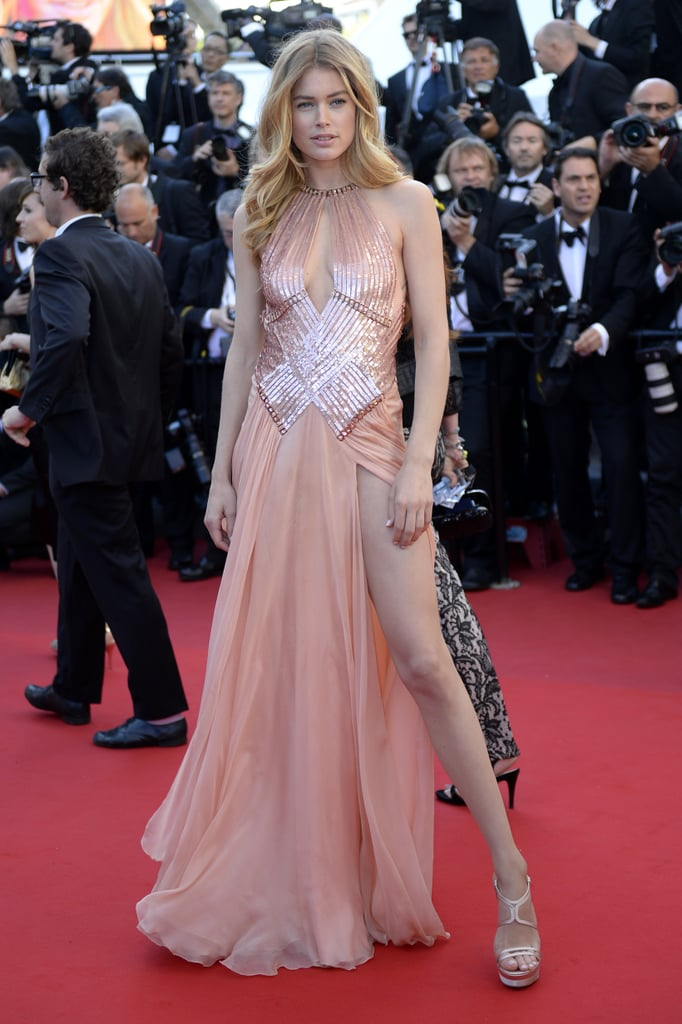 Doutzen Kroes quite literally took our breath away when she stepped onto the red carpet at the Le Passé premiere in this soft, pastel-hued embellished and slit Atelier Versace gown.