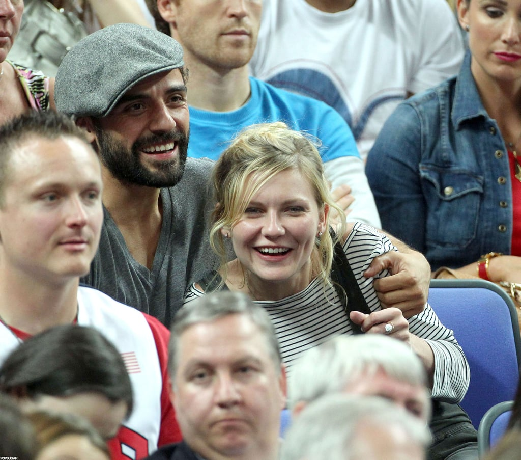 Kirsten Dunst is the latest celebrity to get in on the Olympic action in London. Last night she drank beer and cheered from the crowd while Team USA beat Australia 119-86 in the women's basketball quarterfinals. Kristen was joined by a few friends, including the very handsome Oscar Isaac. Just last month, Kirsten was with her boyfriend, Garrett Hedlund, in NYC. Garrett and Kirsten met while filming On the Road and their big-screen chemistry can be seen in the latest On the Road trailer. The film opens in the UK Oct. 12, with the London premiere scheduled for next Thursday, but there's still no official release date for the States. There is, however, another important release date on the horizon for Kirsten. She shares the big screen with Isla Fisher, Lizzy Caplan, and James Marsden in the sure-to-be-hilarious comedy Bachelorette, which hits US theaters Sept. 7 in limited release.